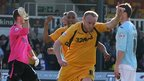 Lee Minshull celebrates equalising for Newport County a minute after they had gone behind against Exeter City in League Two