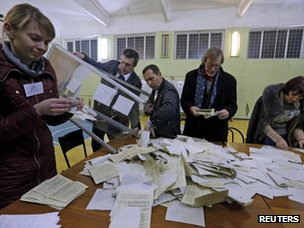 Officials start counting votes of today's referendum in the Crimean capital of Simferopol on 16 March 2014.