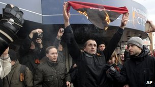Pro-Russian supporters burn a Right Sector scarf during a pro-Russian rally in Kharkiv, Ukraine
