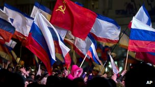 Pro-Russian people celebrate in Lenin Square, in Simferopol, Ukraine
