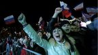People celebrate after voting at Lenin Square in Simferopol, March 16
