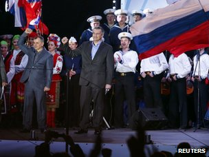 Crimean prime minister Sergei Aksyonov appears on stage in Lenin Square in the Crimean capital Simferopol to the Russian national anthem and in front of Russian flags