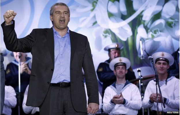 Crimean Prime Minister Sergei Aksyonov celebrates as the preliminary results of the referendum are announced on Lenin Square in  Simferopol March 16