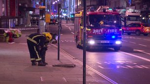 Firemen at the scene of the explosion in Piccadilly