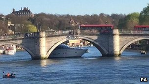 Yacht stuck under bridge