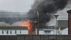Buildings on fire at Ford open prison