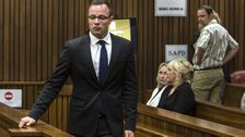 Oscar Pistorius arrives at the court with June Steenkamp, back left, mother of the late Reeva Steenkamp, on 17 March