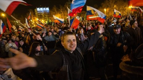 Pro-Russian people celebrate in the central square in Sevastopol, Ukraine