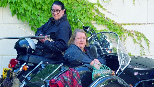 Jennifer Paterson and Clarissa Dickson-Wright on their motorbikes in series one of 'Two Fat Ladies'