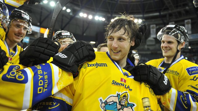 Giants players celebrate with netminder Andrew Dickson on his first home start for the Belfast side