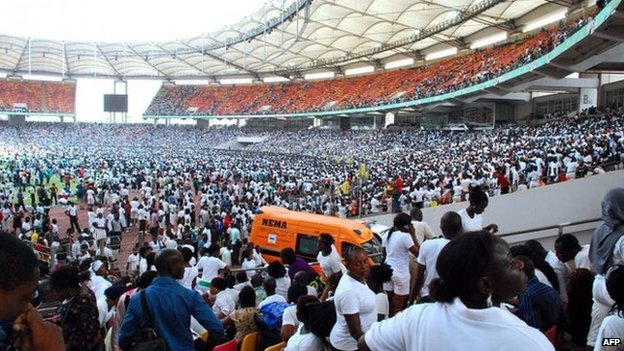 Thousands of job-seekers wait to take an exam in Abuja National Stadium, where they came to apply for work at the Nigerian immigration department, in Abuja, on March 15, 2014.