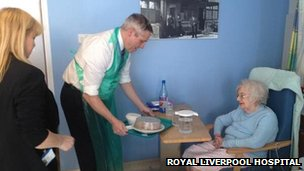 The chief executive of the Royal Liverpool Hospital, Aiden Kehoe, handing out lunches on the wards