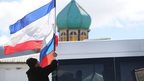 Russian flag in front of Ukrainian military base near Simferopol, Crimea (17 March 2014)