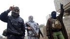 Gunmen walk in the streets of the city of Fallujah, 50 km (31 miles) west of Baghdad January 3, 2014