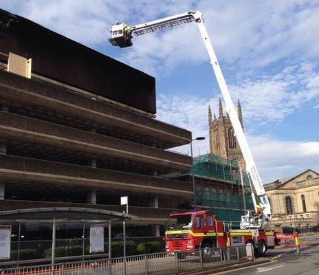 Aerial ladder platform at Derby's Assembly Rooms inspecting fire damage