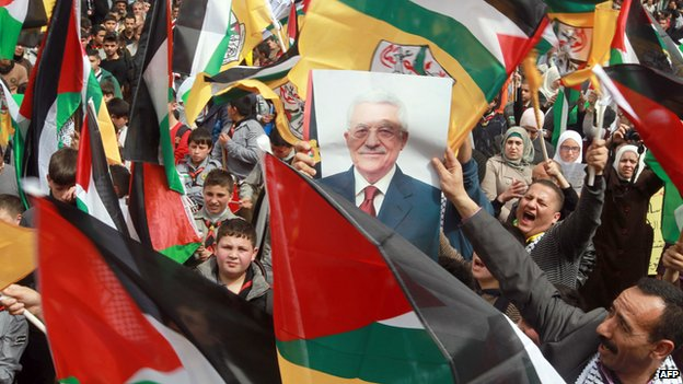 Palestinian flags and posters of President Abbas were carried at a Fatah rally in the West Bank city of Nablus