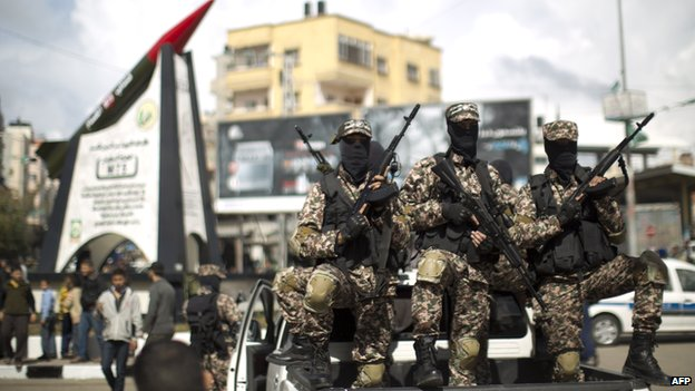 Members of Hamas's military wing, the Izz al-Din al-Qassam Brigades, in Gaza City (10 March 2014)