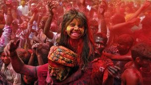 A girl covered in red paint