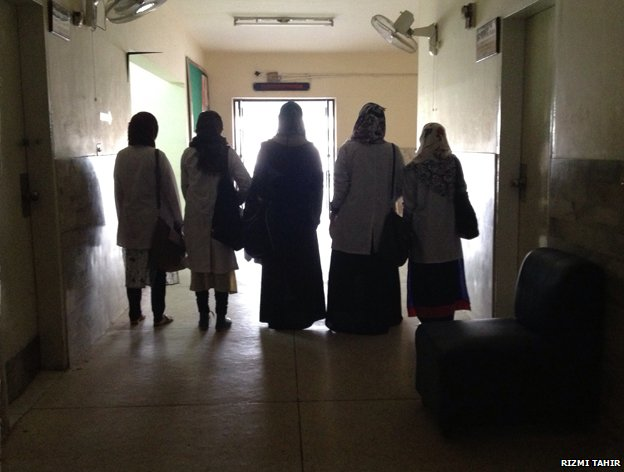 Five women in veils in a building in Pakistan