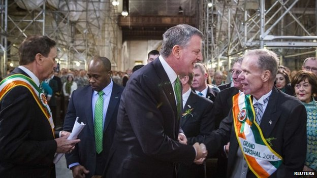 New York Mayor Bill de Blasio greets Grand Marshal of the 2014 New York St Patrick's Day Parade, John (Jack) Ahern, before a service at Saint 17 March 2014