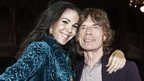 Mick Jagger (right) with designer L'Wren Scott during Fashion Week in New York on 16 February 2012