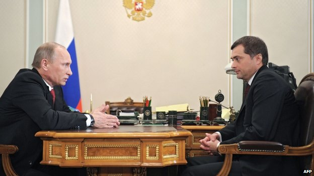 Vladimir Putin (left) talks to Vladislav Surkov in 2011