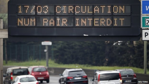 "An electronic road sign reads ""Road traffic forbidden for even-numbered licence plates"" on the Paris ring road"