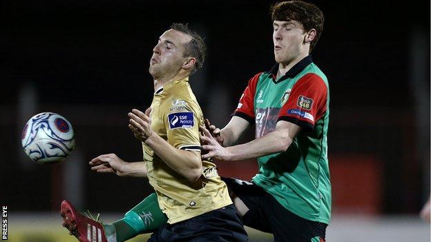 Karl Sheppard of Shamrock Rovers is challenged by Glentoran's Willie Garrett
