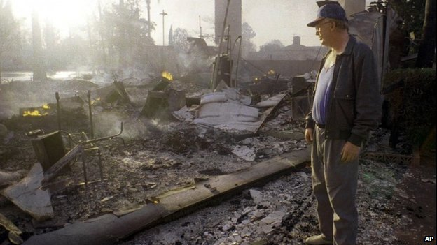 January 1994 file photo of man looking at remains of his home after the Northridge earthquake