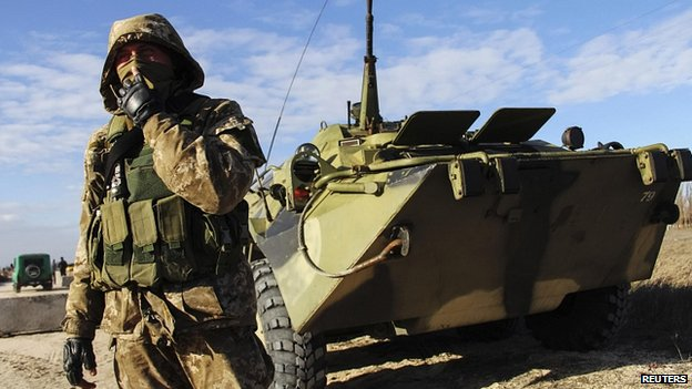 Ukrainian serviceman guards  checkpoint near village of Strelkovo in Kherson region close to Crimea