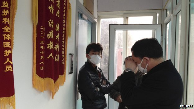 Friends of human right activist Cao Shunli stand in front of an intensive care unit where Cao is hospitalized as they are not allowed to go inside of the unit at a hospital in Beijing in this 1 March 2014 file picture