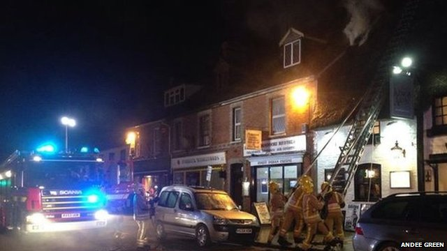 Firefighters tackling the blaze at the King's Arms pub in Wareham