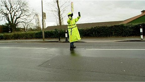 lollipop lady stopping traffic