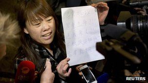 "A relative of a Chinese passenger aboard the missing Malaysia Airlines Flight MH370 shows a paper reading ""Hunger strike protest, Respect life, Return my relative, Don""t want become victim of politics, Tell the truth"""