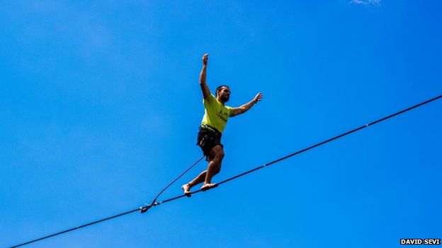 A man on a tightrope