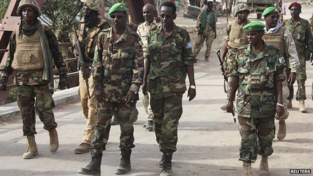 Amisom Djiboutian Commander Col Osman Doubad (C) walks with the Hiran Governor Abdi Farah Laqanyo and Amisom chief of staff Gen Soubaghle, after successfully capturing the al Shabab-held Bulo-burde in the Hiran region of Somalia - 14 March 2014