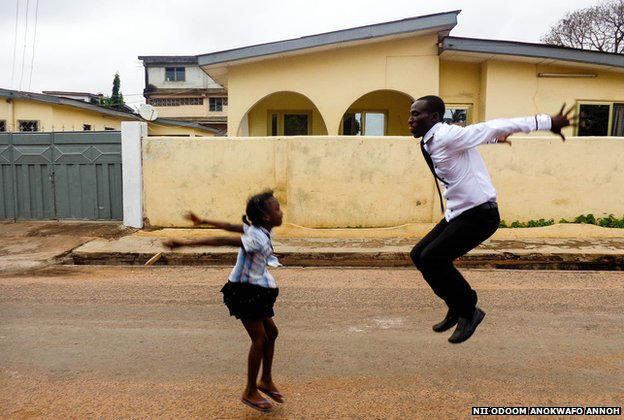 A man  and girl jump