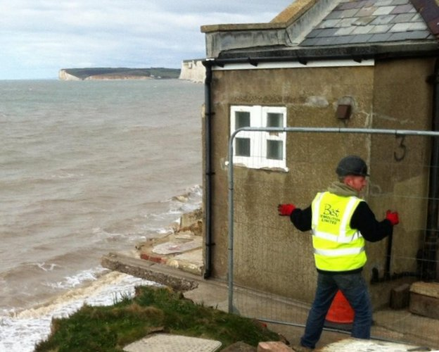 Demolition of a cottage at Birling Gap