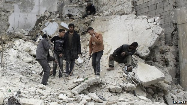 Syrians search for survivors after a barrel-bomb attack in the al-Myassar district of Aleppo (30 January 2014)
