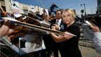 Actress Kate Winslet signs autographs after unveiling her star on the Walk of Fame in Hollywood, California