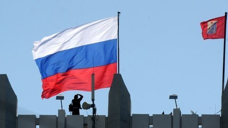 A Russian flag flutters on Sevastopol city hall on March 17, 2014