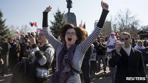 Woman jumps for joy during President Putin's speech