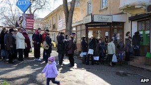 Queue of people withdrawing their deposits from a branch of Ukrainian PrivatBank in Sevastopol