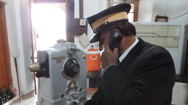 S M Hashmi on the hotline; his right hand is at the handle of the token block instrument made in Calcutta in 1923 which is still ensuring train safety on the Attock block-section