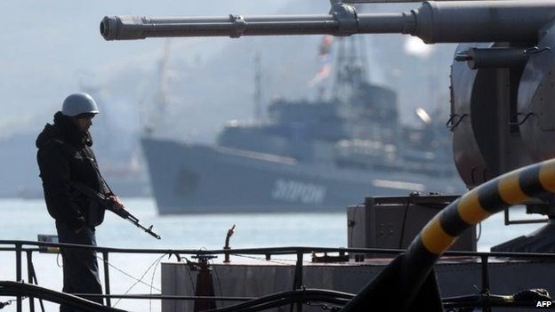 A sailor stands guard on Ukraine's Slavutych military ship in Sevastopol, 18 March