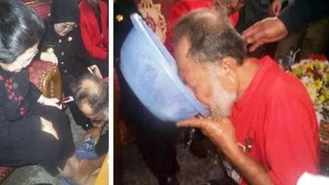 Image of man drinking water used to wash former Indonesian president's feet