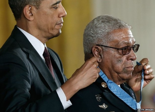 President Barack Obama awards the Medal of Honor to former US Army Staff Sgt Melvin Morris at the White House on 18 March 2014
