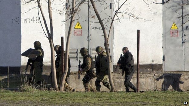 Armed men near military base in Simferopol. 18 March 2014
