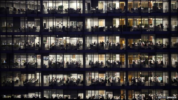 Office workers for IPC Media work late into the night in the Blue Fin Building in Southwark in 2010