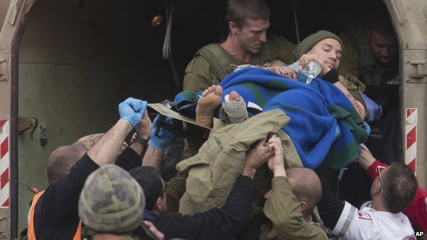 A wounded Israeli soldier is taken to a hospital after a bomb blast in the Golan Heights on 18 March 2014